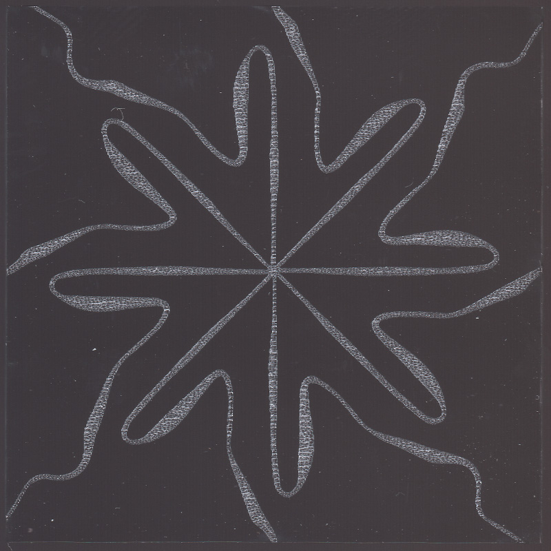 Radial pattern with eight curving lines etched on glass